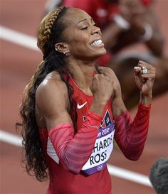 United States' Sanya Richards-Ross celebrates her win in the women's 400-meter final. Defending champion Christine Ohuruogu of Britain finished second in 49.70 and American DeeDee Trotter, decked out in red, white and blue glitter on her face, won the bronze in 49.72.
