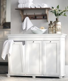 Functional and beautiful bathroom decor-- A tilt-out laundry hamper from HomeDecorators.com