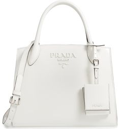 A modern twist on the iconic Prada logo bag, this beautifully structured satchel crafted from pristine leather boasts matching matte lettering for a subtle take on the branded look.