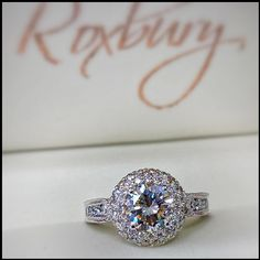 If you're going to propose, make it a #RoxburyOriginal  The crown jewel of this 14kt White Gold custom designed #DiamondHalo #EngagementRing is a spectacular 1.02ct Round J-SI1 GIA Diamond* center stone.