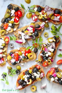 Mixed olive bruschetta. Great for the parties ahead. For a vegan version omit the feta cheese. #bruschetta #olives