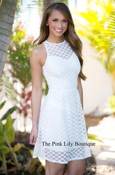 They'll all be chasing after you in the girly white lace dress. Features a high neckline, fit and flare bodice, pleated skirt, and zip closure in the back.  Pair with your favorite sandals or wedges.