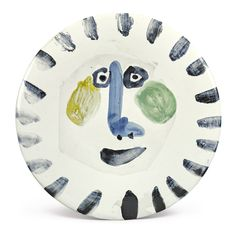 Pablo Picasso VISAGE (NEZ À ANGLE DROIT) Dated 21.6.63. (on the reverse) Painted and partially glazed ceramic; round plate Diameter: 10 in. 25.4 cm Executed on June 21, 1963; this work is unique.