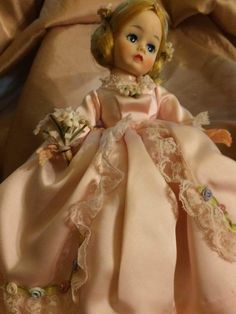 This Jennie Lind is from the late 1960s. Her face is high color, her body is perfect, with bright blonde hair and her blue eye shadow. Her eyes close when she is laid down. She is holding a bouquet of flowers, and wearing a crinoline under the pink satin dress. | eBay!