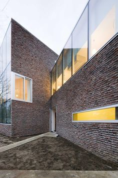 Stine-Gybels House by Pierre Hebbelinck The rough brick is in stark contrast to the smooth aluminium frames and glazing, and is intended to attract moss growth.