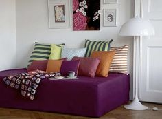 Daybeds always seem luxurious - not in and of themselves, but the mere fact that you might have room for a daybed seems luxurious. But maybe we're thinking about them all wrong. A daybed is actually one of those multipurpose pieces of furniture that can be useful in small homes - couch-like seating during the day and a bed at night. Pretty perfect for a playroom or kids' room that needs to double as a guest room on occasion.