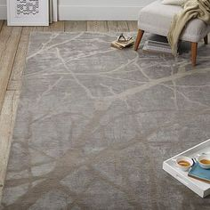 If you are going for pulling in the natiure elements, like the stone at the front, then this rug would pull in the tree branches  Winter Branches Rug #westelm