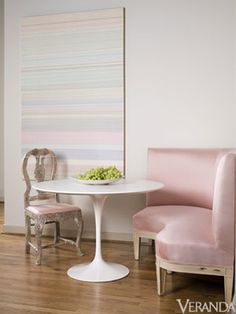 Time to Dine: a leggy pink satin corner banquette paired with a Saarenin tulip table invite you to breakfast every morning. Interior Designer: Pamela Pierce.