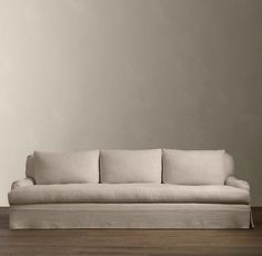 """RH Belgian Classic Roll Arm Slipcovered Sofa. 108"""" wide. 41"""" or 46"""" deep. $5512."""