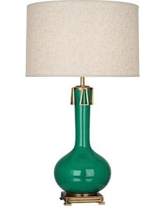 With charming tassel-like accents at the neck, this Robert Abbey Athena table lamp comes in a beautiful emerald green finish. This distinctive Robert Abbey table lamp will illuminate your home as it enhances your decor with contemporary style.