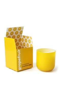 "Grapefruit Pop Candle in a bright yellow container.  Measures: 3.25"" diameter x 3.25"" H; 7.5 oz; 40 hour burn time  Grapefruit Pop Candle by Jonathan Adler. Home & Gifts - Home Decor - Candles & Scents Rhode Island"