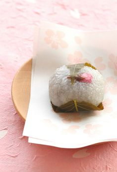 Japanese sweets -sakura mochi- : made from mochi-rice and salted cherry leaf + flower petal, serving only in spring. There are literally millions of different kind of sweets/cakes in Japan, serving up to the seasons and occasions.