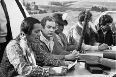 Russell Means announces AIM's settlement with the U.S. government as negotiator Ken Frizzell of the Department of Justice and Oglala Lakota chief Tom Bad Cobb look on. (Associated Press)