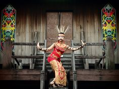 Dayak girl with Mandau weapon