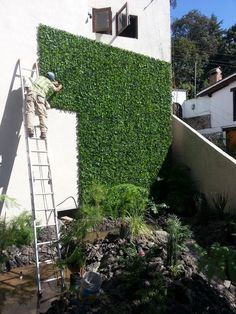 The latest project. Artificial leaf panels give this stark white wall a vertical garden feel without the maintenance and upkeep of regular hedge panels.