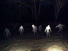 Zombie cutouts with lights. Very simplistic but still effective for Halloween!
