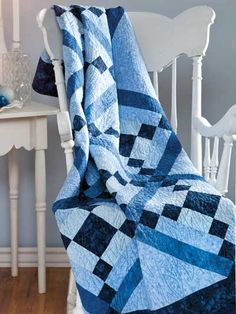 """Winter Blues Technique - Quilting  Grab your collection of blue fabrics and start piecing this simply dramatic throw. The bold geometric design is a real stash buster. This e-pattern was originally published in the December 2011 issue of Quilter's World magazine.   Size: 47 5/8"""" x 67 1/2"""". Block Size: 12"""" x 12"""".  Skill Level: Beginner"""