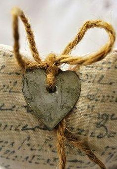 tin heart on printed burlap- so rustic...