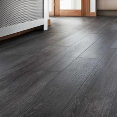 Choose our Quickstep Livyn silk oak dark grey vinyl flooring and give your home a clean, smooth look. For more inspiration, visit Howdens. Grey Wooden Floor, Wood Look Tile Floor, Grey Wood Tile, Grey Floor Tiles, Wood Tile Floors, Wooden Floor Tiles, Vinyl Flooring Bathroom, Luxury Vinyl Flooring, Luxury Vinyl Plank