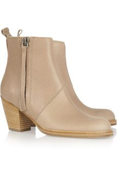 Acnepistol leather ankle boots in a pale-mocha shade with a blonde wood stacked heel. I would complement the neutral tone with shapes of caramel and dove-grey for the most sophisticated finish.
