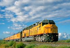 This photo from Arizona, West is titled 'Eastbound At Union Pacific Railroad, Railroad Photography, North America, Trains, Diesel, Arizona, United States, Business, Places