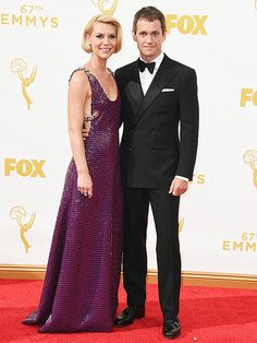 Claire Danes and Hugh Dancy at the Emmys 2015 Claire  in a cabernet and navy sequin-covered Prada gown with chain straps and accents. Her husband wore a Ralph Lauren Black Label double-breasted black tuxedo.