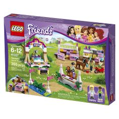 LEGO Friends Heartlake Horse Show (41057) - LEGO - toysrus.com $39.99.  Very nice!  2 horses, 2 figs, one male! 2 horses, 1 brown, 1 chocolate. A rake, a wheel barrow, a red pail, jumps, grooming section, 2 stable stalls, Winners cups & platform.  Want 10 of this.