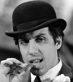 Adriano Celentano. Bruta faccia, bella voce. Strike that, reverse it.