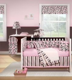 NOT bedding for Shea??? They painted the walls here pink on the top and dark gray on the bottom. A thin darker pink line where they meet, maybe a narrow molding.