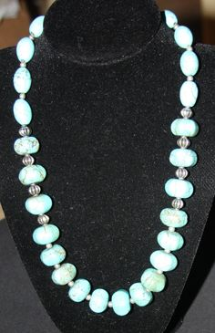 Turquoise Necklace $55  It is not this long on the neck.. I will measure it and post the length.