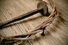 Photo about A depiction of the crown of thorns of Jesus Christ with blood and a nail on the Holy Cross. Image of holy, christian, blood - 49604623