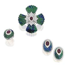 Suite of 18karat Gold, Platinum, Azurmalachite, Diamond and Ruby Jewellery by David Webb. Comprising a brooch, ring and a pair of earclips, the brooch designed as a Maltese cross set with four fluted wedge-shaped azurmalachite segments, centered by a cabochon ruby and round diamonds weighing aprox 5.70 carats, signed David Webb; fitted with a retractable pendant loop. The bombé style fluted azurmalachite ring centering a cabochon ruby, accented by round diamonds weighing aprox 1.65c, size 5…