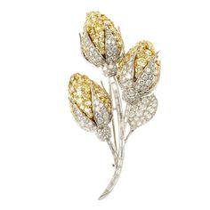 A diamond floral spray brooch.