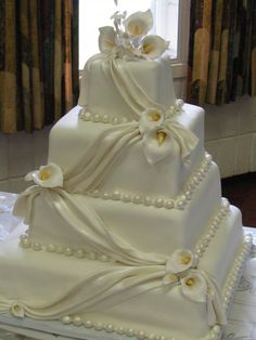 A beautifully draped wedding cake with pearl and calla lily accents by The Cakery in Fredonia NY. Square Wedding Cakes, White Wedding Cakes, Wedding Cake Designs, Wedding Ideas, Elegant Wedding Cakes, Beautiful Wedding Cakes, Gorgeous Cakes, Calla Lillies Wedding, Calla Lilies