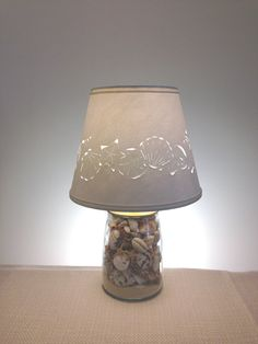Packed with a variety of beautiful seashells and a couple starfish, this small seashell filled lamp is only 13 high--this is from the top of