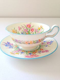 This lovely teacup and saucer houses an array of inviting blossoms. In wonderful condition.    This teacup and saucer are standard size.