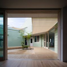 """Hakemiya Nursery School by Rhythmdesign and Case-Real   All """"home rooms"""" face onto a shared central courtyard"""