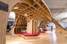"""New York-based creative agency Barbarian Group has unveiled a brand new """"superdesk"""" in their office. Made out of 4,400 square feet of plywood, the desk is so large that the entire company –all 125 employees– can share it."""