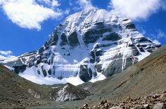 Mount Kailash tour is a lifetime pilgrimage to Mt.Kailash and Lake Manasarovar. A kora trip here wonderfully integrates the spiritual, cultural and physical dimensions. Experience the Mt. Kailash Yatra with the best price and pleasant services. Iceland Trekking, Kailash Mansarovar, Vajrayana Buddhism, Sacred Mountain, Helicopter Tour, Tibetan Buddhism, Pilgrimage, Cool Photos, Around The Worlds