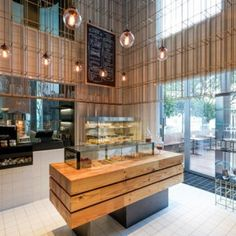 Bakery and wine shop interior design brass grid structure cages patisserie in by home improvement thrift . bakery and wine shop interior design Wine Shop Interior, Retail Interior, Shop Interior Design, Retail Design, Design Interiors, Bakery Design, Cafe Design, Restaurant Design, Store Design