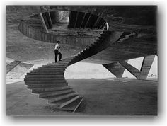 Affonso Eduardo Reidy walking up the sprial stair of his Museum of Modern Art in Rio De Janero while under construction in 1953. Via.