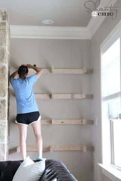 floating shelves......ashley-installing-shelves... Start with 2 by 4 constructed capital E frames attached on the starts... Build up hardwood plywood and one by six for the top and sides of each shelf... Put into place and secure perhaps with pegs or screws... used hardwood plywood to close out the bottom, screw those into place... stain everything before mounting and then touch up in place