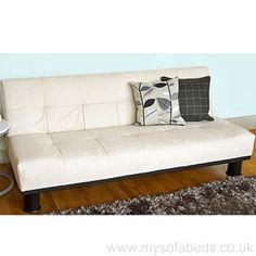 Faux suede click clack sofa bed in cream. Deep padded comfort with medium-firm support. Free, fast UK delivery.