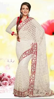 Elegant Off White Embroidered Sari Give in to the exotic confluence of today & tomorrow in this beautiful attire. Look ethnic in this affluent off white net sari. Look ravishing clad in this attire which is enhanced jaal work, resham, stones & unique border work work. #WeddingSaree #EmbroideredDesignerSari