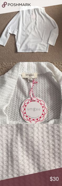 """Umgee White off the shoulder sweater. NWT Umgee White off the shoulder sweater. Size medium. Color is white. New with tags. Brand is umgee but bought from nanamacs.  50%COTTON 40%POLYESTER Hemline to Hemline: 26"""" Waffle Texture Dolman Sleeves Lightweight   **Model is wearing a size small Umgee Sweaters"""