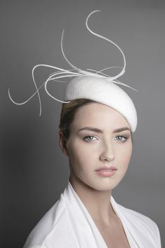 A couture feather wedding percher hat with dramatic feather details. Our  elegant wedding hat is c062a3b369c6