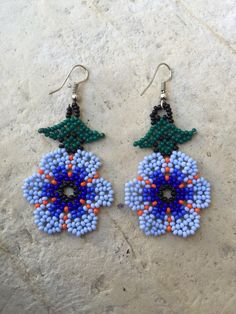 A personal favorite from my Etsy shop https://www.etsy.com/listing/269137201/sweet-huichol-beaded-earrings-2-long