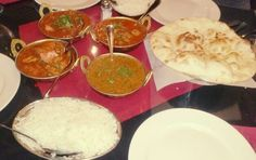 Indian food. Lamb, goat, chicken curry and black peas.