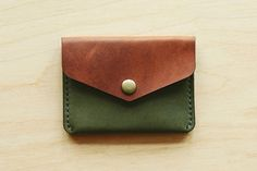 Winter Session Handmade leather buttoned wallet.