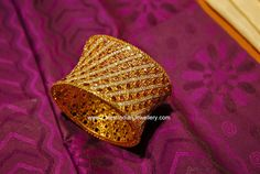 stunning designer gold bangle